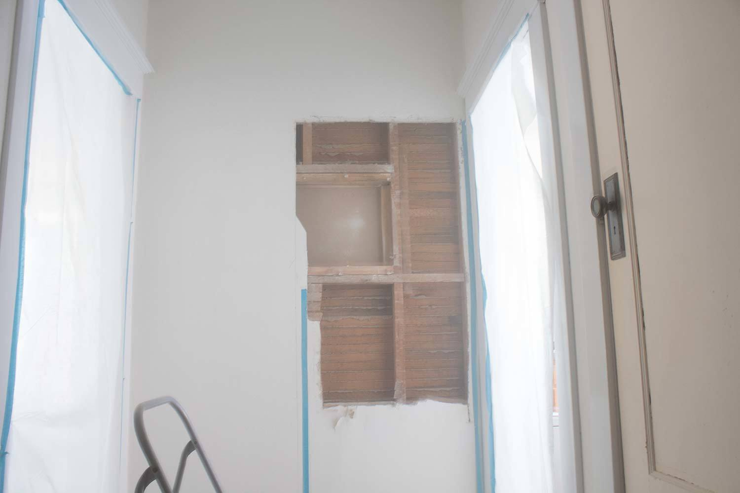 The full process of how I safely opened the wall and added a doorway to my laundry room. #DIY #HomeImprovement #Doorway #OpeningAWall #AButterflyHouse