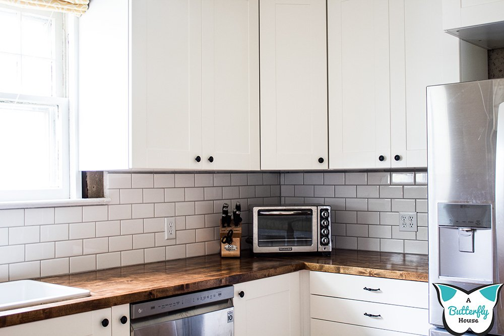 DIY tips for installing subway tile backsplash in your kitchen even if your walls are wavy! #AButterflyHouse #Kitchens #Tile #Backsplashes #DIY #Projects #DIYProjects #SubwayTile