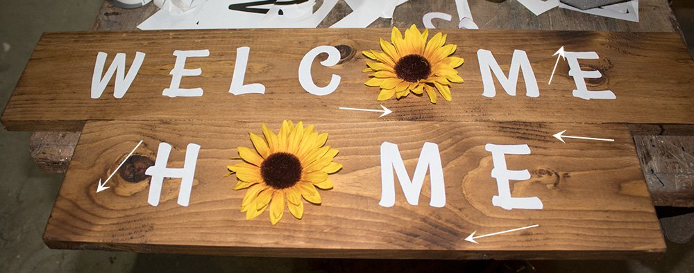 Welcome your family home with this cute DIY farmhouse sunflower sign made from scrap wood and dollar store flowers! This full tutorial shows you exactly how to make this cute sign for your entryway! #AButterflyHouse #Farmhouse #Flowers #DIY #DIYDecor #DIYProjects #Scrapwood #DollarStoreCrafts #WallArt