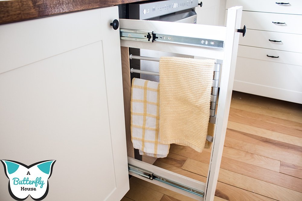 Make your kitchen more organized and functional with a DIY Built-In Towel Rack next to your sink! #AButterflyHouse #DIY #DIYProjects #HomeImprovement #Kitchen #TowelRack #BuiltIns #Organization #Storage #Tutorial #HowTo