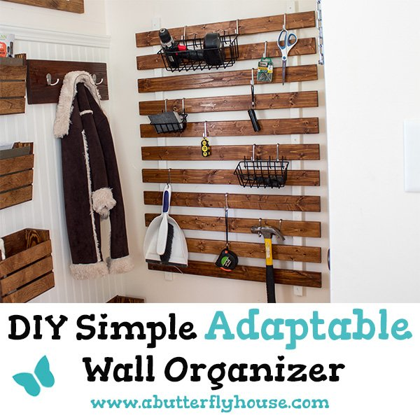 See how to make an adaptable DIY rustic farmhouse wooden wall organizer with this full tutorial. The organizer can be used to store tools, kitchen supplies, craft supplies, or almost anything else you can think of! #AButterflyHouse #DIY #DIYProjects #Farmhouse #Organization #Garage #Kitchen #StorageIdeas