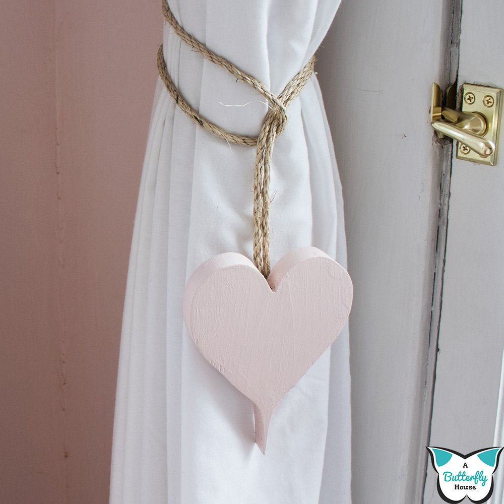 I love these simple DIY Heart Curtain Ties! They're a quick and practical way to add some easy DIY Valentine's Day Decor with just a little scrap wood and rope! #AButterflyHouse #ValentinesDay #ValentinesDayDecor #DIY #DIYProjects #CurtainTies #ScrapWood
