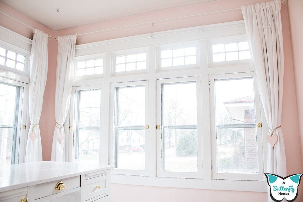 Hanging curtains on plaster walls can be super difficult. But hanging these curtain rods was pretty simple after I realized this one trick! #AButterflyHouse #DIY #HomeImprovement #WindowTreatments