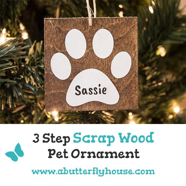 These super cute DIY scrap wood ornaments are an easy way to honor your pet on your Christmas tree. Some scrap wood, sticker paper, and twine is all it takes! #AButterflyHouse #DIYOrnaments #DIY #DIYProjects #ChristmasCrafts #Ornaments #ScrapWood #ScrapWoodProjects