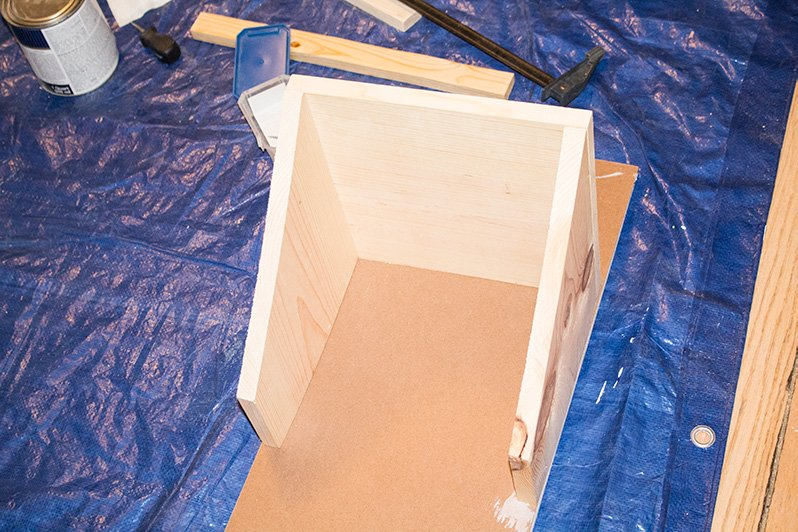 Grungy wall cabinet becomes beautiful and functional tilt-out trash can in this simple DIY! #FurnitureFlips #DIYProjects