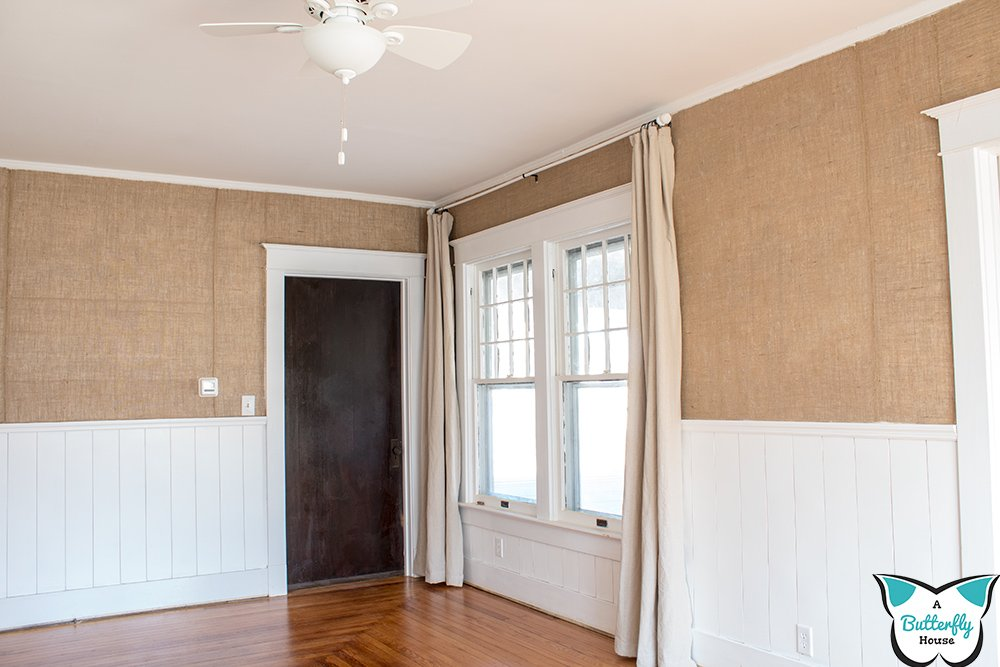 Love shiplap? Check out this DIY Vertical Shiplap Half Wall, a timeless way to add shiplap to a room! #HomeImprovement #DIYShiplap