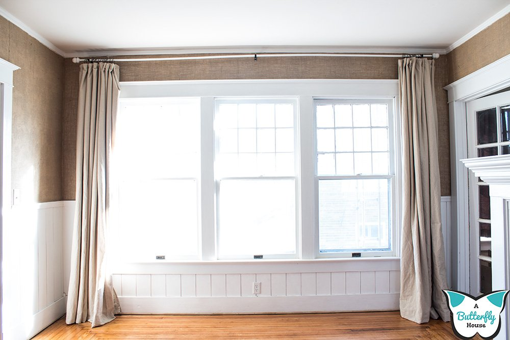 You've got to see this simple and easy way to add blackout lining to store bought curtains. Done in 10 minutes or less! #WindowTreatments #BlackoutLining