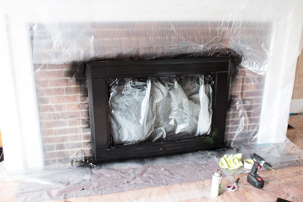 Want an easy fireplace update? Learn how to spray paint that brass insert with this full DIY tutorial! #FireplaceUpdate #HomeImprovement