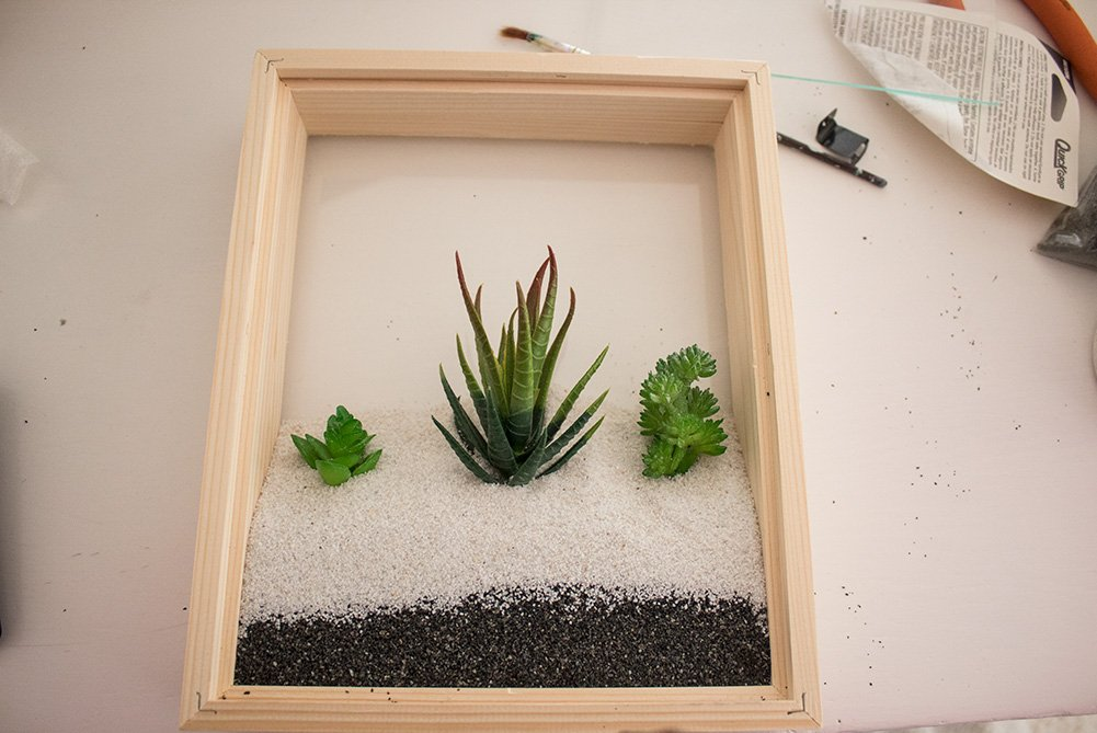 Got some small fake succulents that need a new home? Check out this simple DIY Faux Succulent Planter! No tools required!