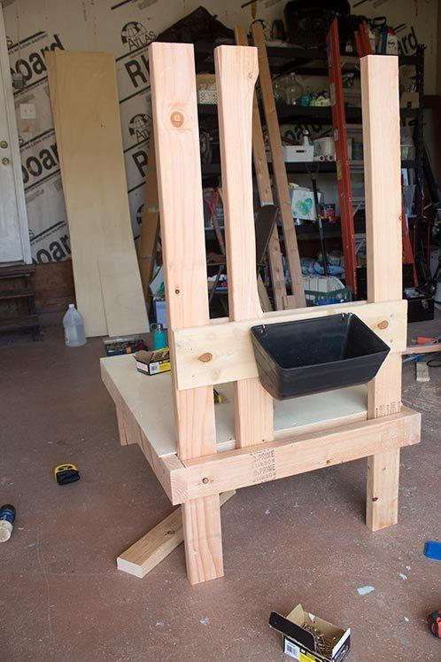 These DIY goat milking stand plans are easy and inexpensive. Includes full photo tutorial with free printable plans! #homesteading #diyproject