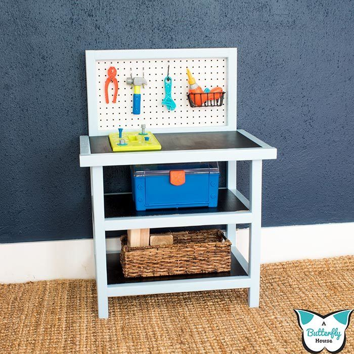 This DIY Kids Workbench is perfect for your budding builder!  The children's toolbench tutorial has step by step photos and comes with free printable plans! #woodworking