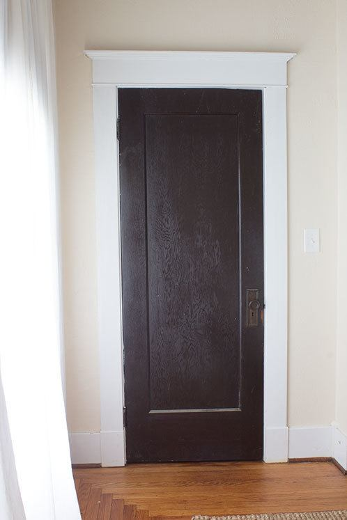 This quick makeover turns a boring brown door into a fabulous faux french door. Quick project requires only trim and paint! #homeimprovement
