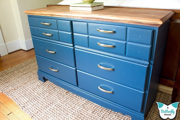 This in-depth furniture flip turns a thrifted dresser into a practical pull-out hamper. Includes detailed photo and video tutorials! #furnitureflip #furnituremakeover