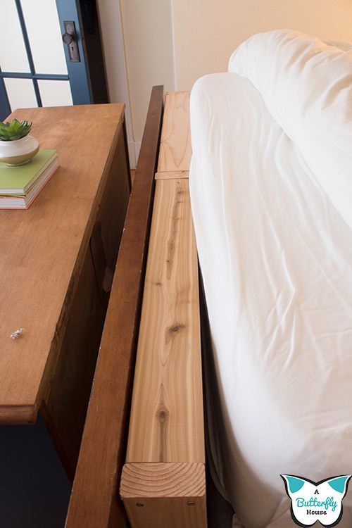 Wondering how to keep pillows from falling behind your bed? Check out this easy DIY Headboard Mattress Gap Filler, made from scrap wood pieces! Done in under 30 minutes, it's the perfect fix to your problem! #ScrapWoodProject