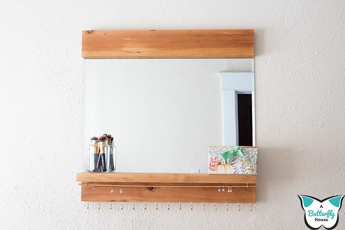 This DIY Mirrored Jewelry Organizer is easy to make and a super practical addition to any girl's bedroom! An easy afternoon scrap wood project! #DIY #Woodworking