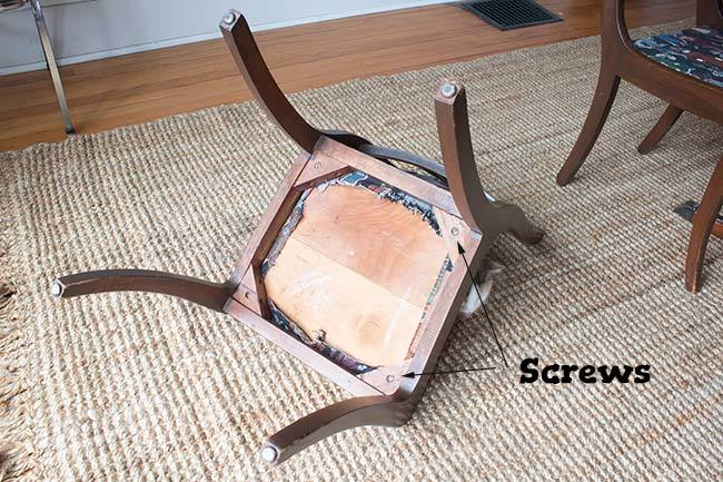 Replace a dining chair cushion the easy way with this complete tutorial! DIY, budget-friendly method doesn't require any tools to replace a chair seat, and each chair can be done in under 30 minutes. #upholstery #DIY