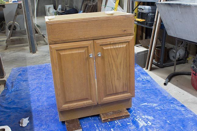 Learn how to paint laminate cabinets in a bathroom or kitchen. An easy paint project that can completely transform a room! #DIY #HomeImprovement