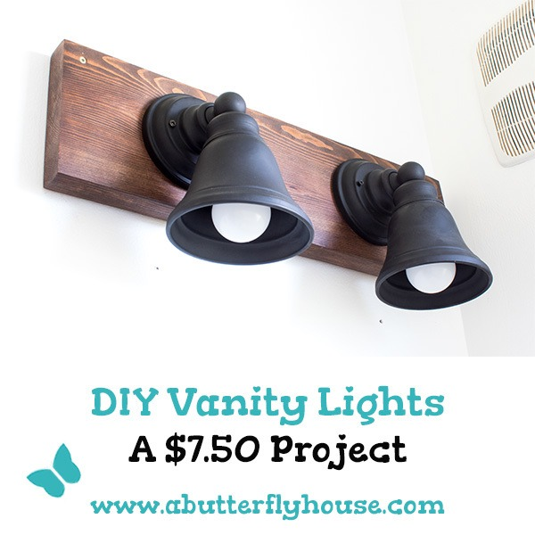 Make budget-friendly DIY Vanity Lights for your bathroom! These DIY industrial style lights are a gorgeous upgrade from builder-grade materials! #Lighting #DIY