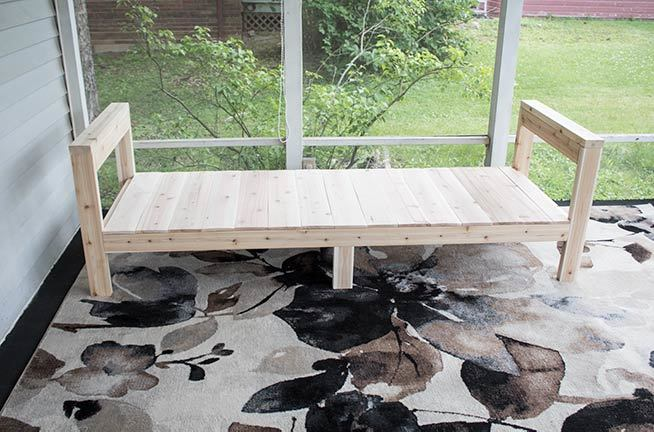This DIY Outdoor Sofa, complete with free printable plans, is an easy weekend build. Made of cedar, this couch is ready for any weather! #OutdoorFurniture #Woodworking