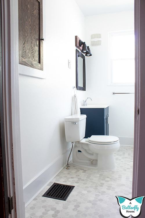 This DIY bathroom before and after was done for under $200! It's a budget friendly way to upgrade a bathroom for yourself or to sell your home! Come check out the full room reveal! #HomeImprovement #RoomReveal