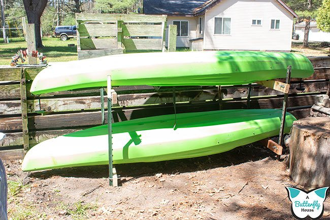 This DIY Kayak Rack is the perfect place to store your kayaks! The outdoor kayak rack is easy to use and make! #Storage #Kayak #DIYStorage