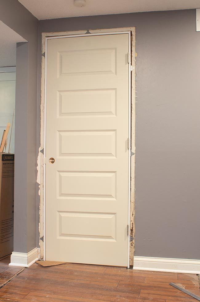 Installing an interior door is an easy project with the right supplies! Come see how I installed a pre-hung door in my workshop! #homeimprovement