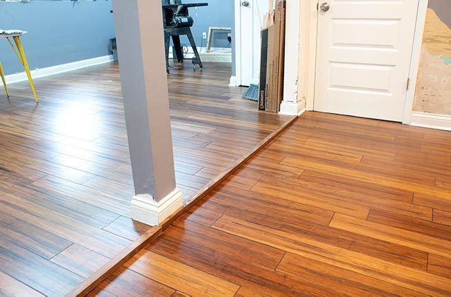 Installing click and lock engineered hardwood floors is an easy DIY that will save a ton of money! Improve your home on a budget with this diy-friendly floor upgrade! #homeimprovement #flooring