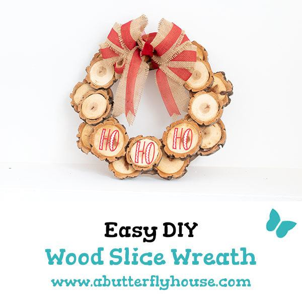This diy wood slice wreath is easy to make and the perfect holiday decor. Add a bit of rustic charm to your home with this easy holiday craft. Burlap, ribbon and wood slices make a gorgeous combo! #christmascrafts #diydecor