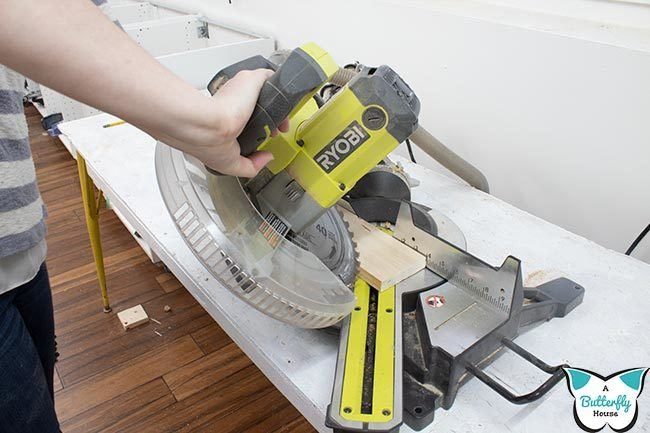 Miter saw making a combo miter/bevel cut. Learn how much miter saws cost with this in-depth article.