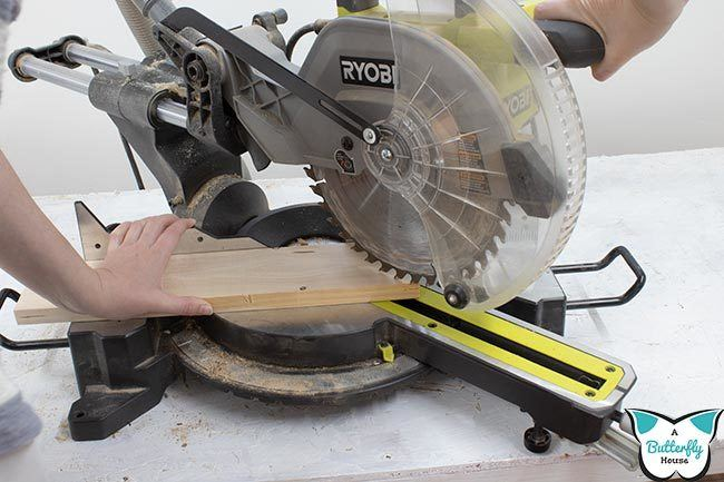 Miter saw making a combo miter cut. Learn how much miter saws cost with this in-depth article.