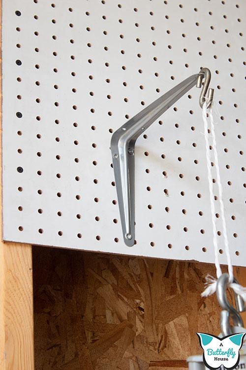 Shelf bracket on pegboard